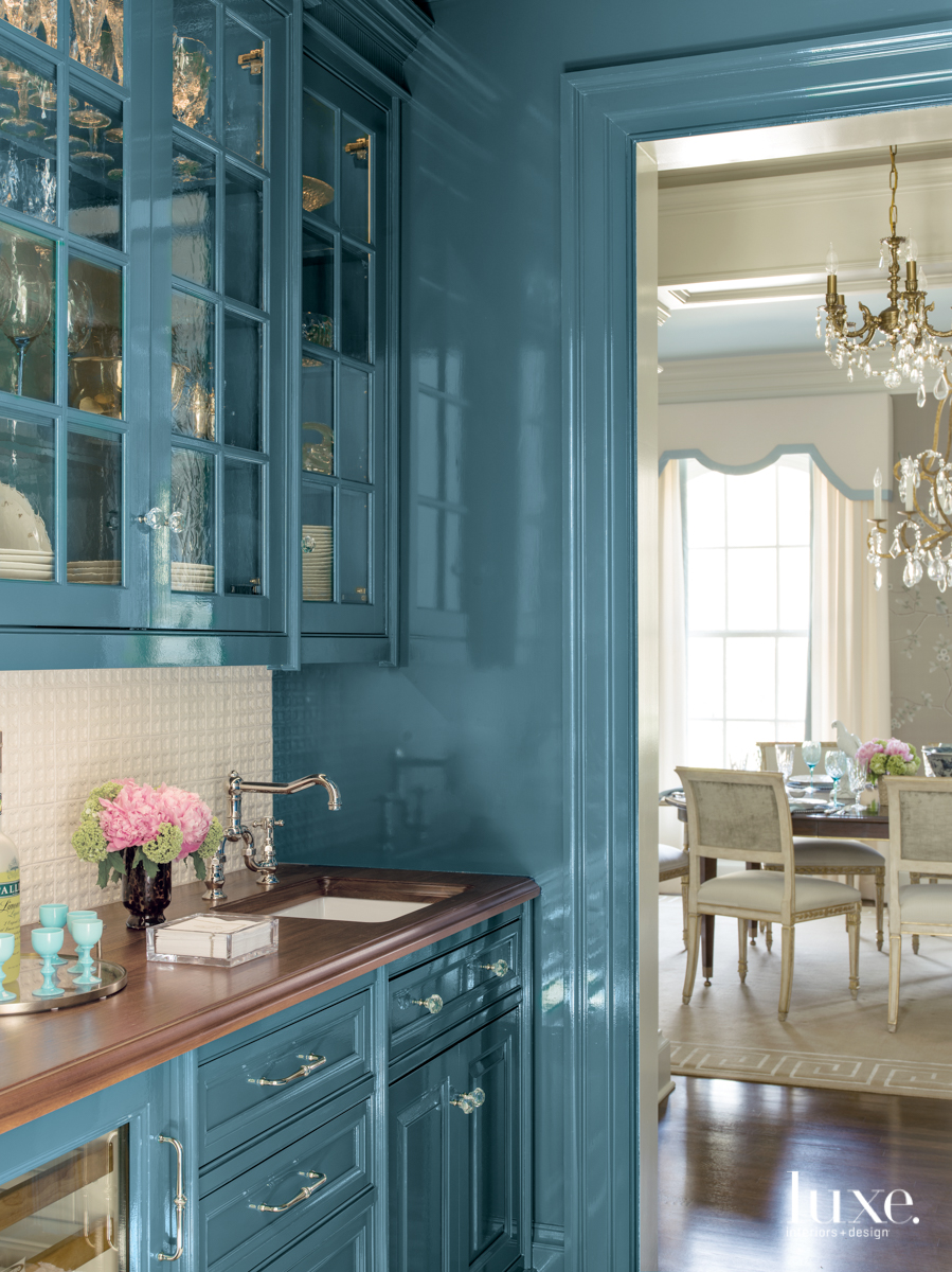 traditional pantry blue cabinetry
