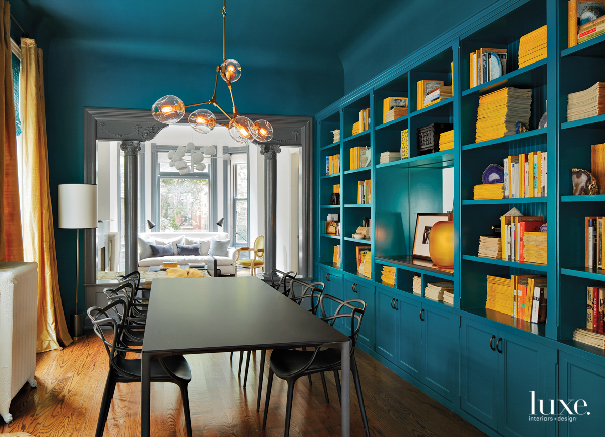 contemporary blue dining room bookshelves