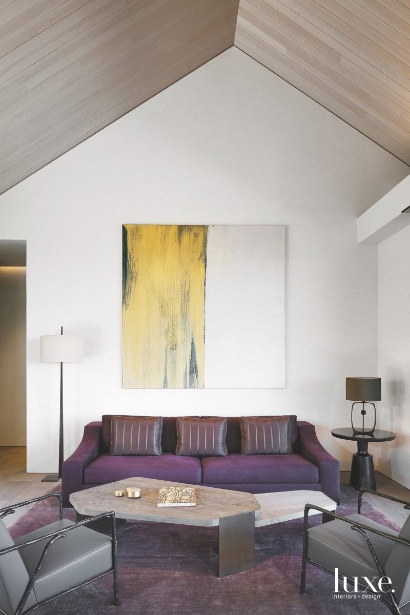 A plum-toned Liaigre sofa and...