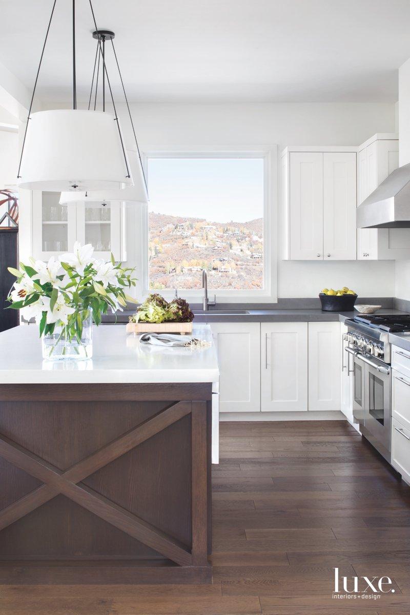 contemporary white kitchen brown island