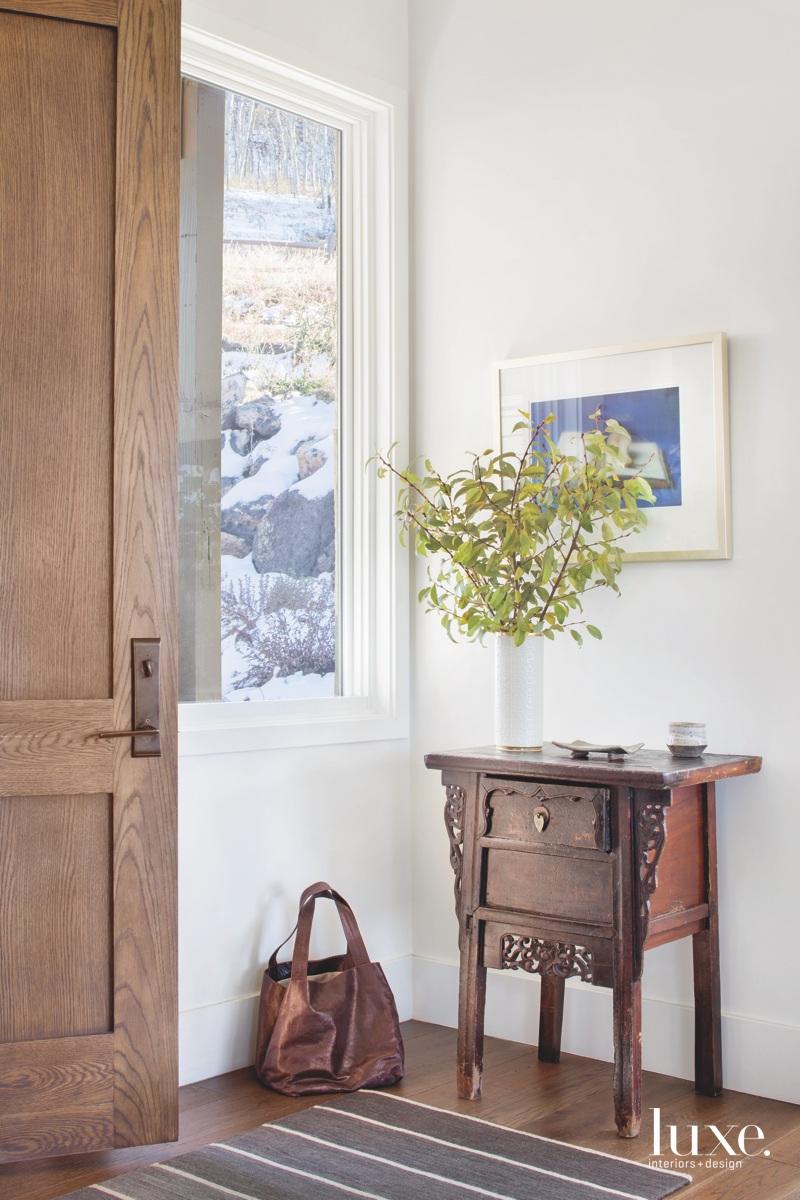 contemporary entry brown wood door...