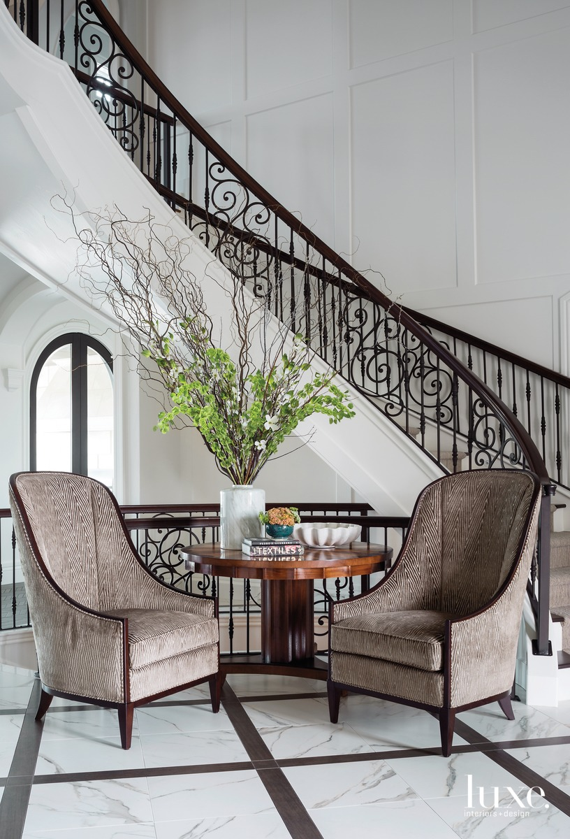 traditional neutral foyer staircase sitting...