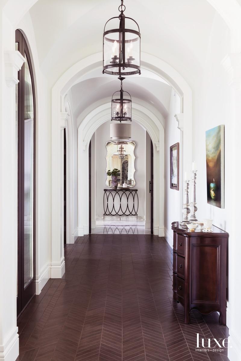 traditional hallway dark porcelain chevron...