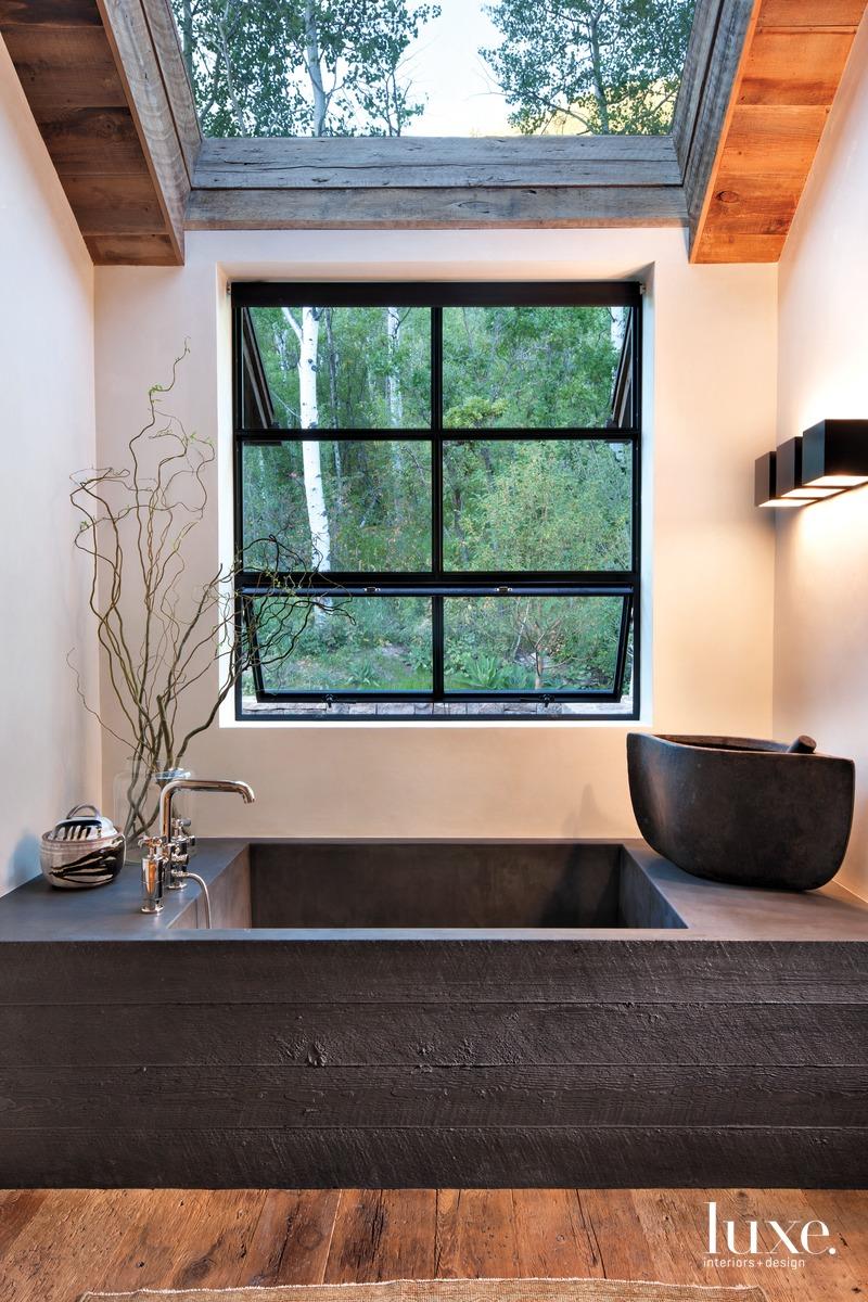 industrial bathroom neutral black-concrete tub