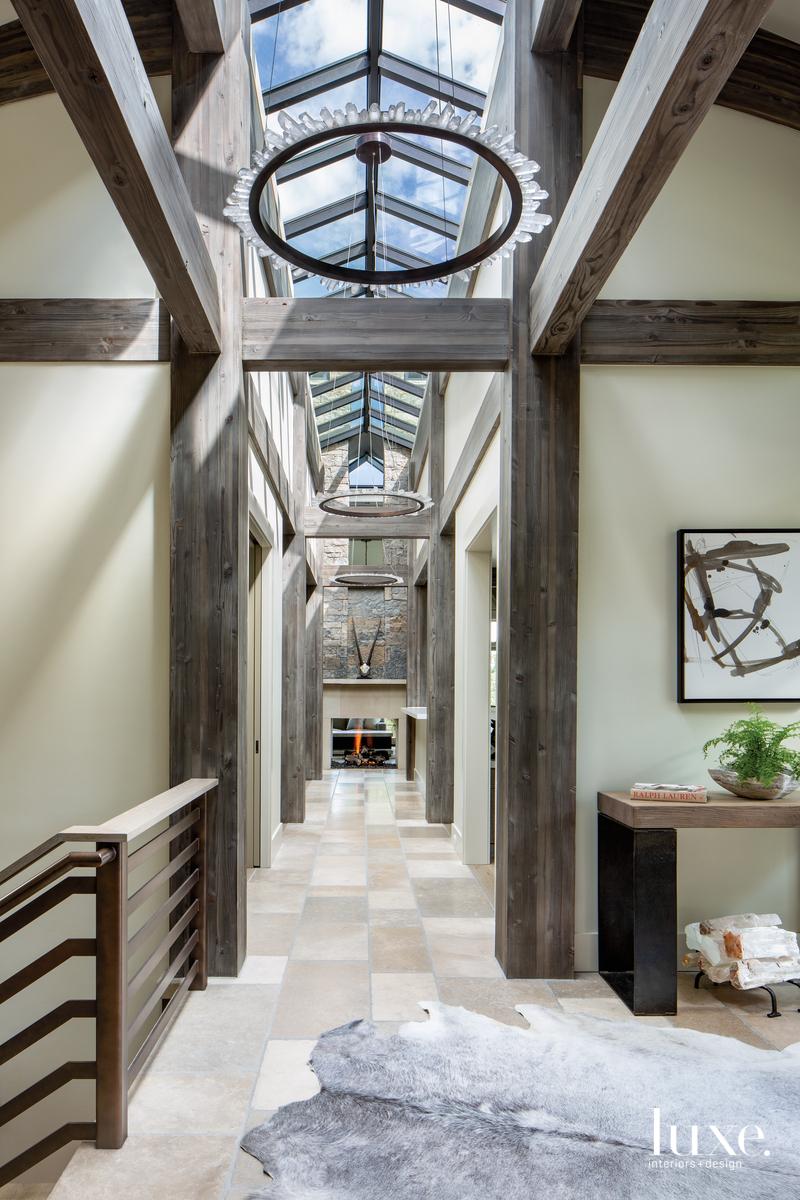 mountain hallway chandeliers fireplace