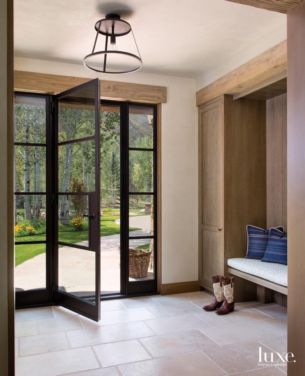 rustic neutral entry metal-framed door...