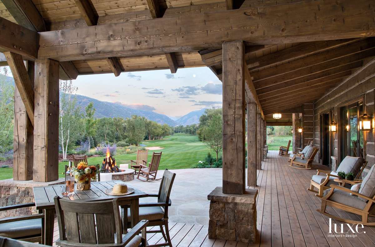 rustic exterior sitting area fire...