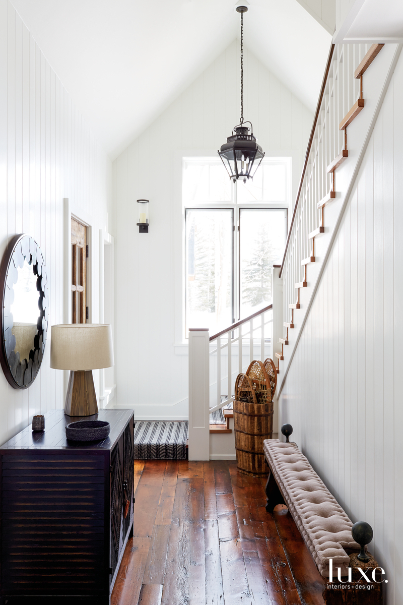 transitional hallway white walls staircase...