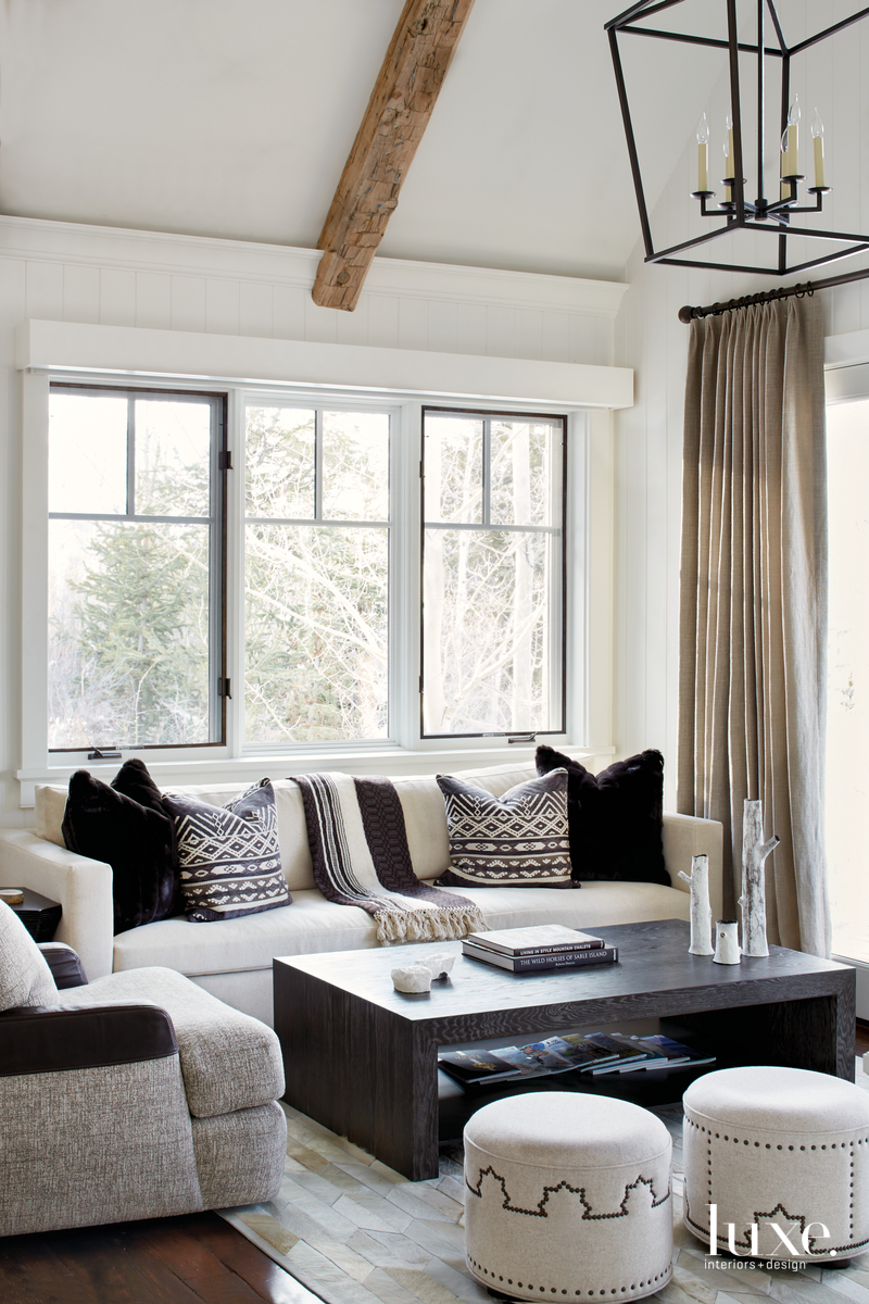 transitional living room white sofa...