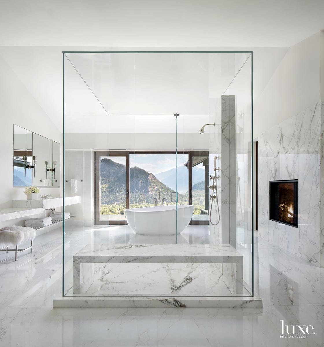 contemporary white bathroom glass-enclosed shower...
