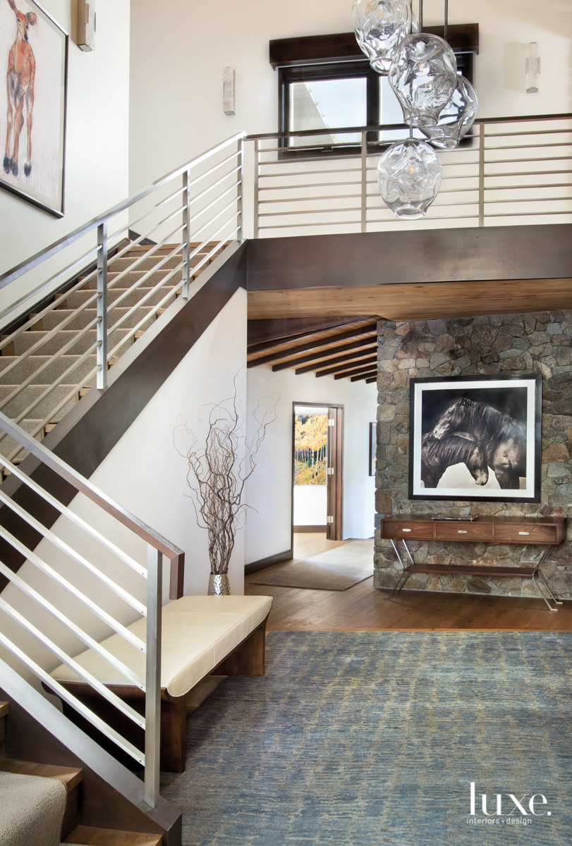 transitional entry staircase steel railings...