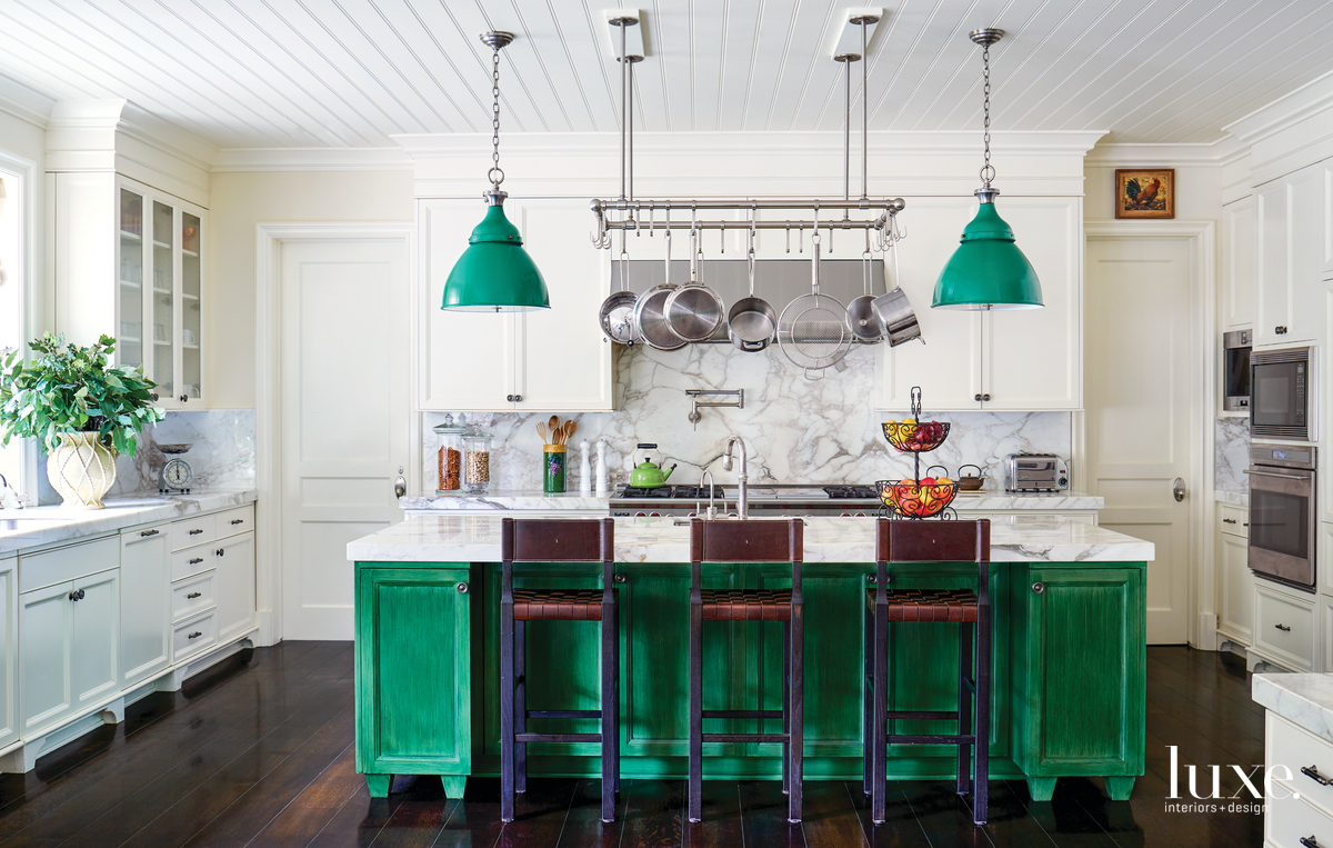 traditional white kitchen green island...