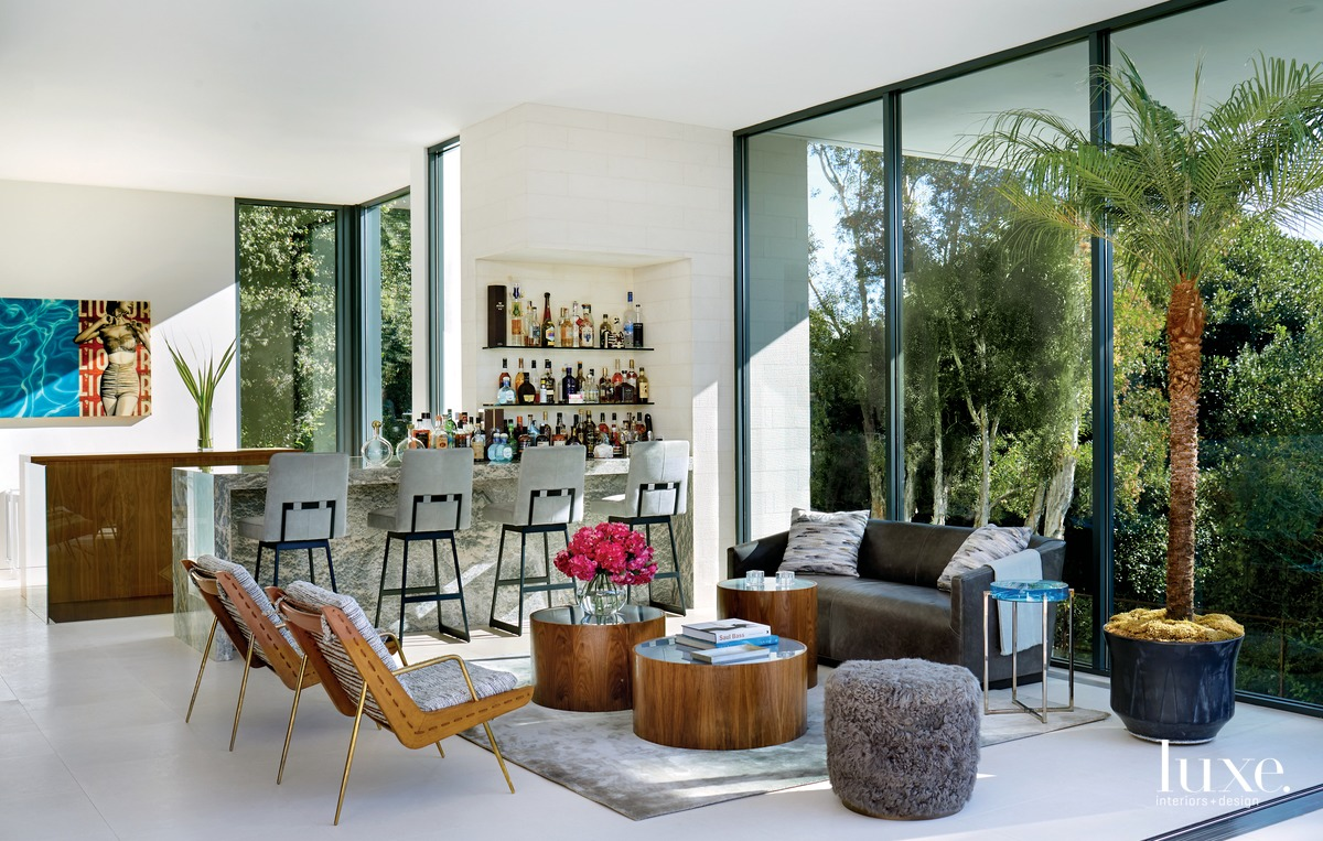 contemporary living room floor-to-ceiling glass...