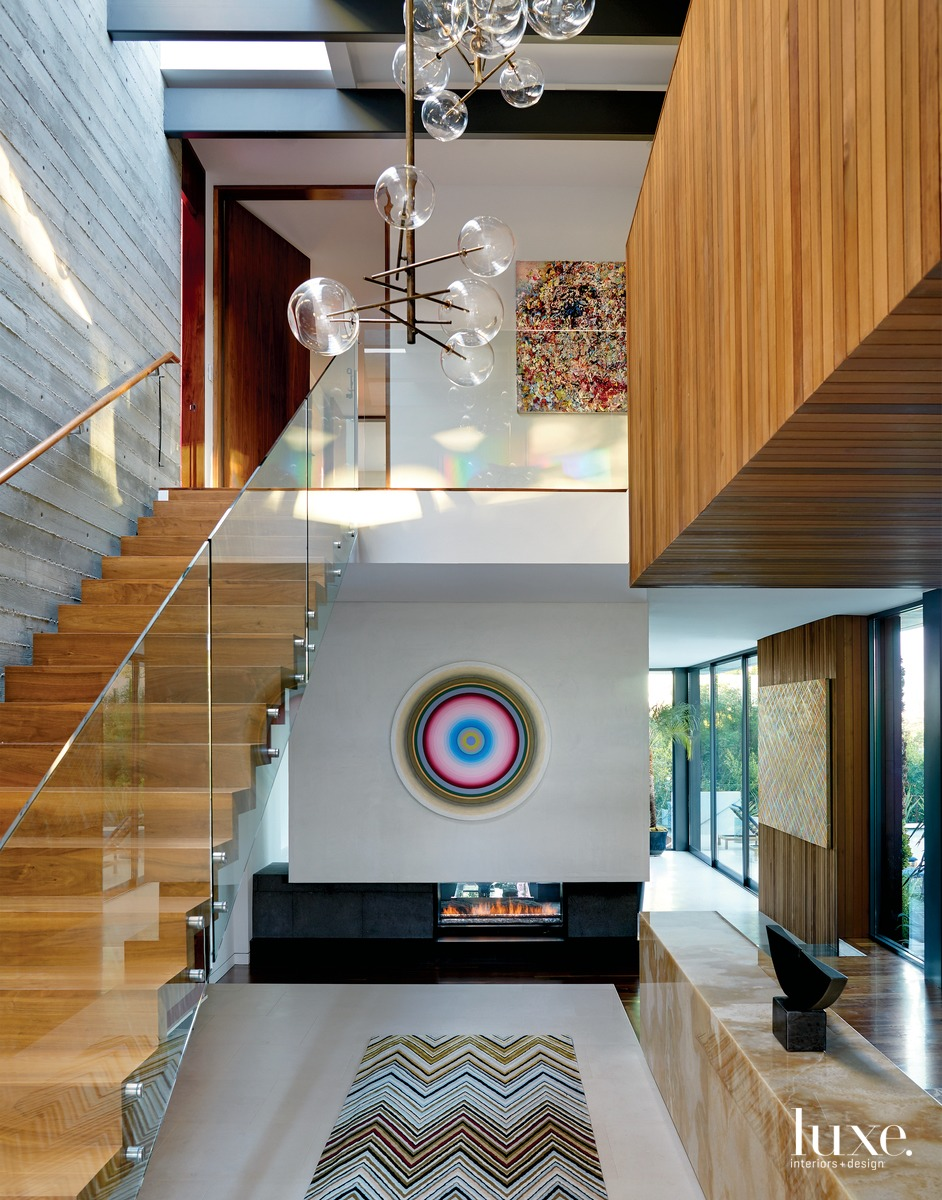 contemporary foyer staircase colorful art