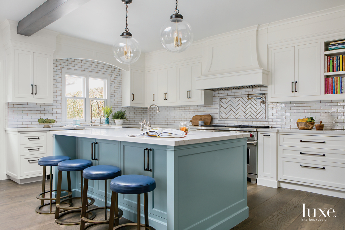 traditional white kitchen blue island...