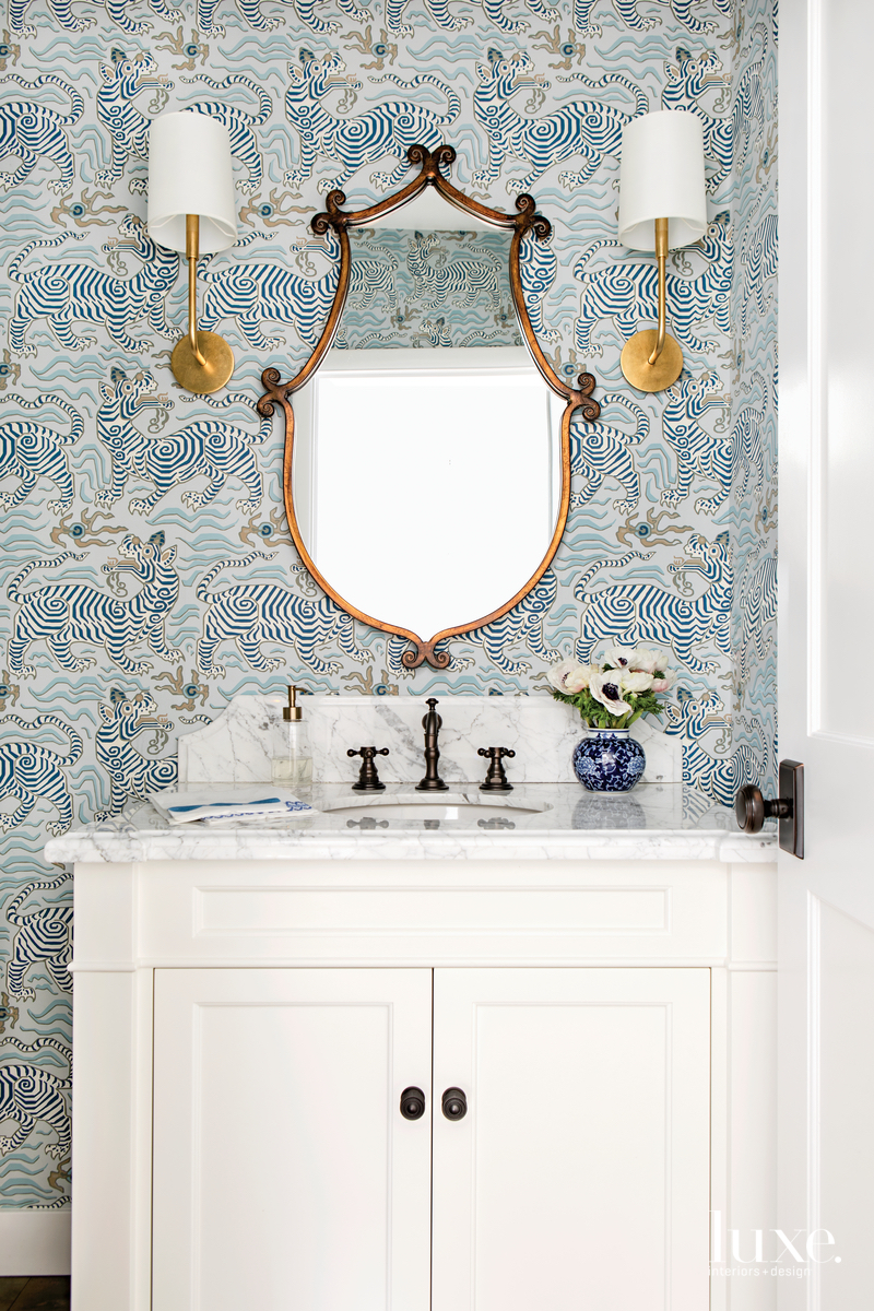 traditional bathroom white cabinetry blue...