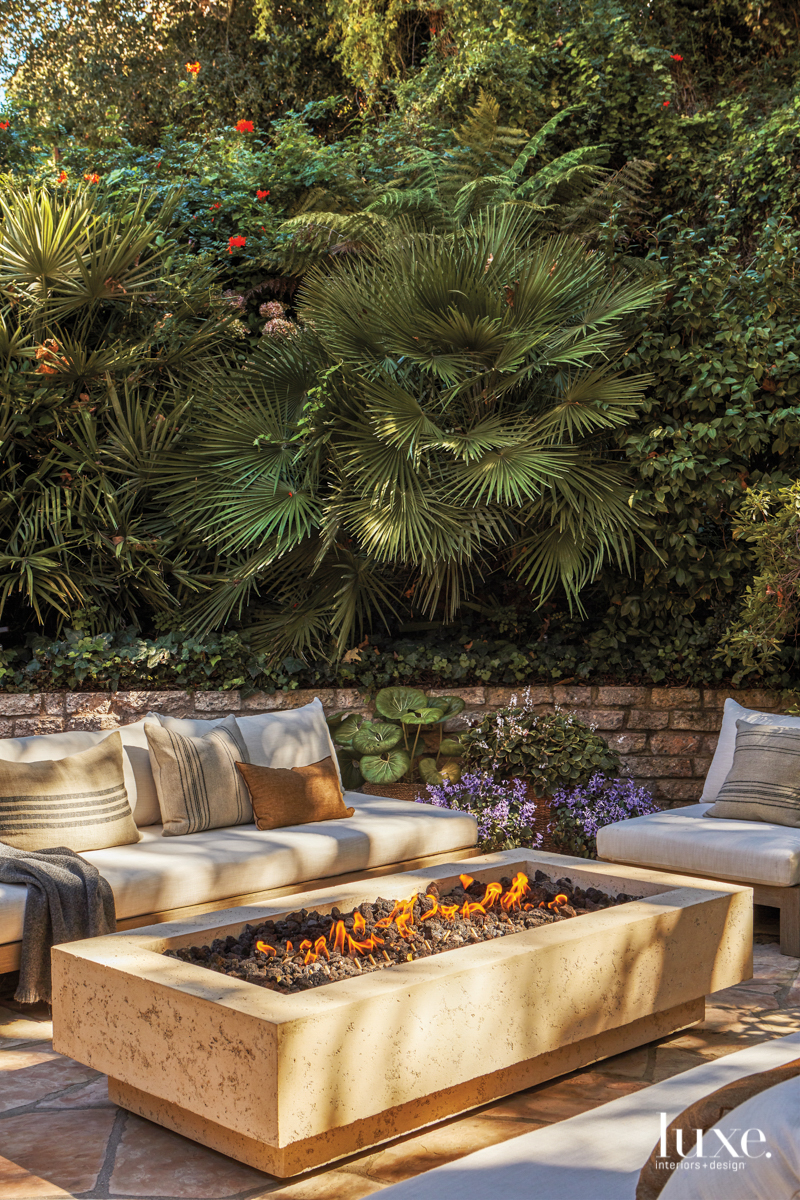 contemporary exterior sitting area fire...