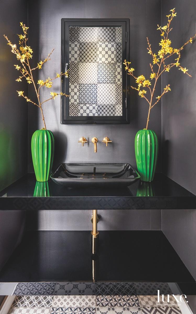 contemporary black bathroom green vases