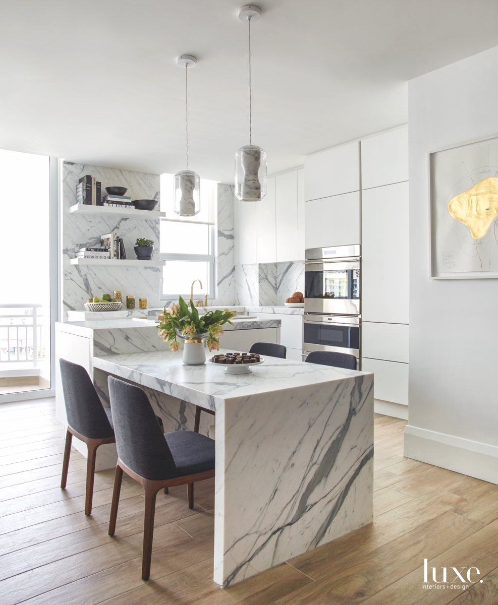 contemporary white kitchen marble island...