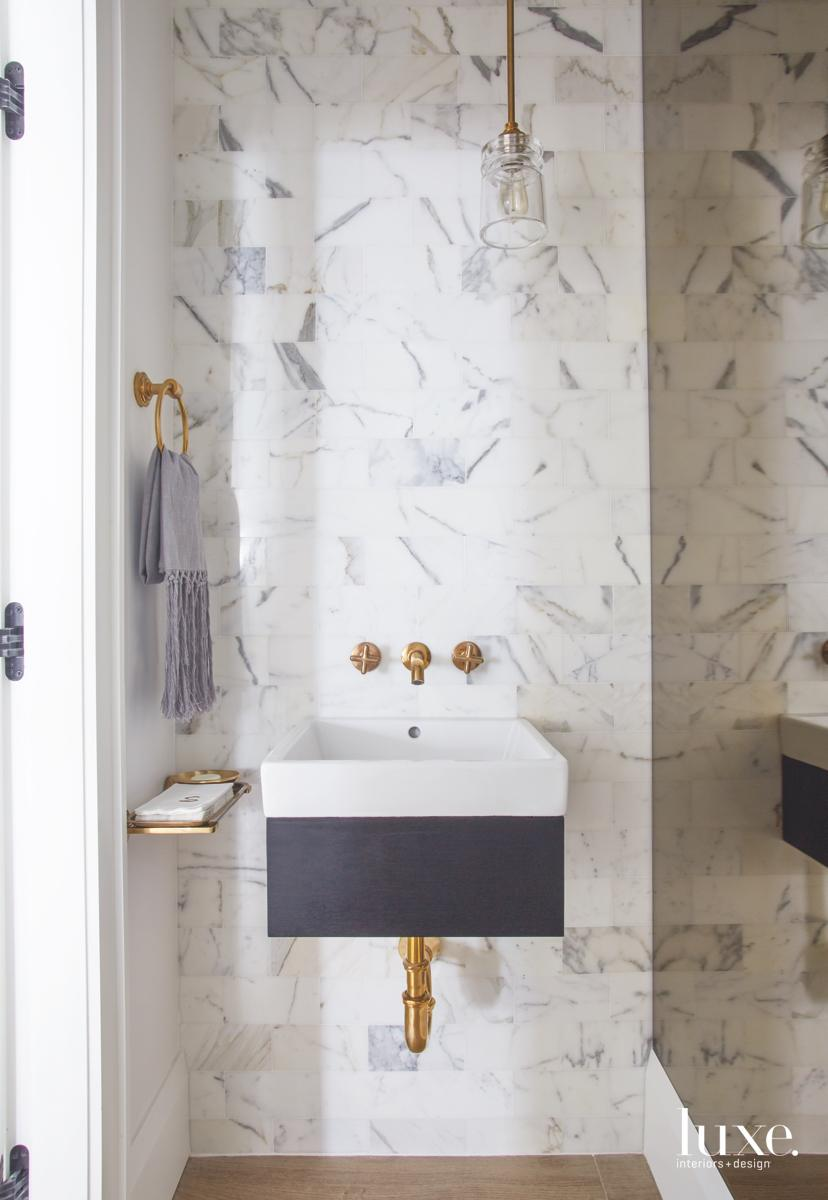 contemporary white marble bathroom gold...
