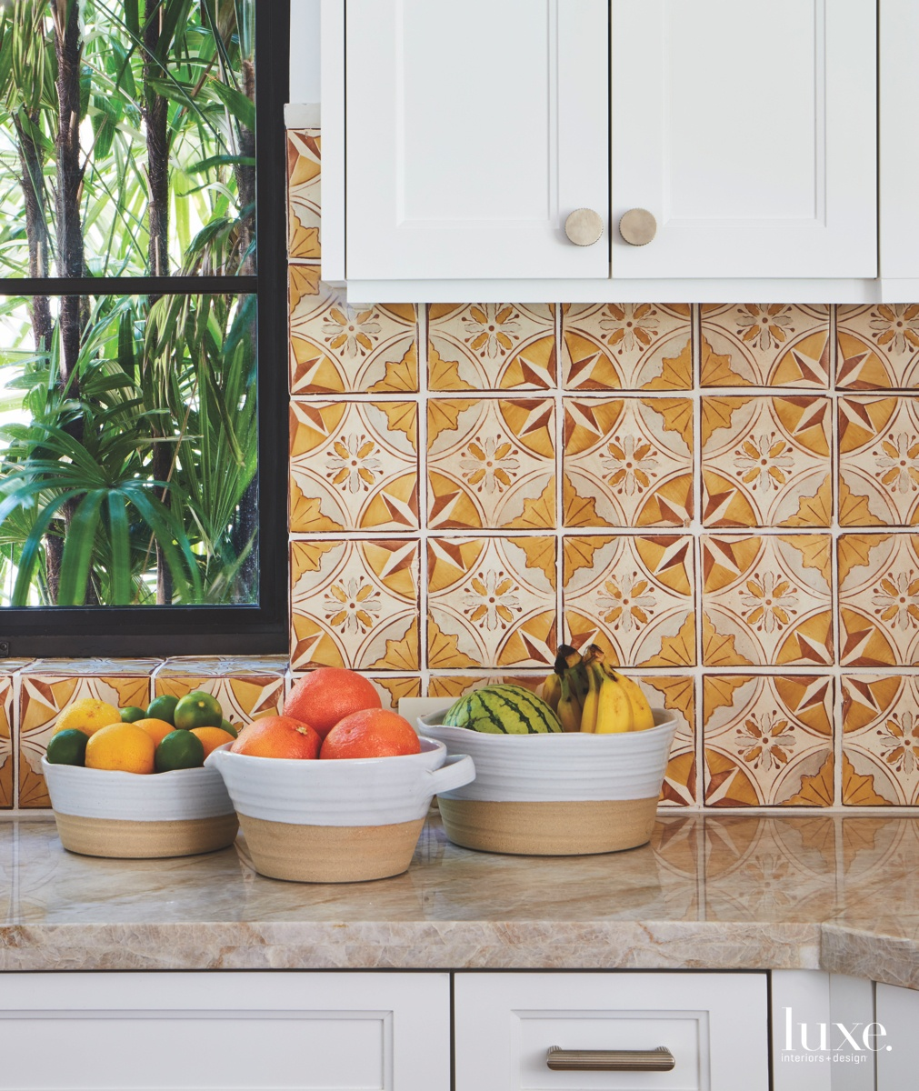 eclectic kitchen marble countertops white cabinetry