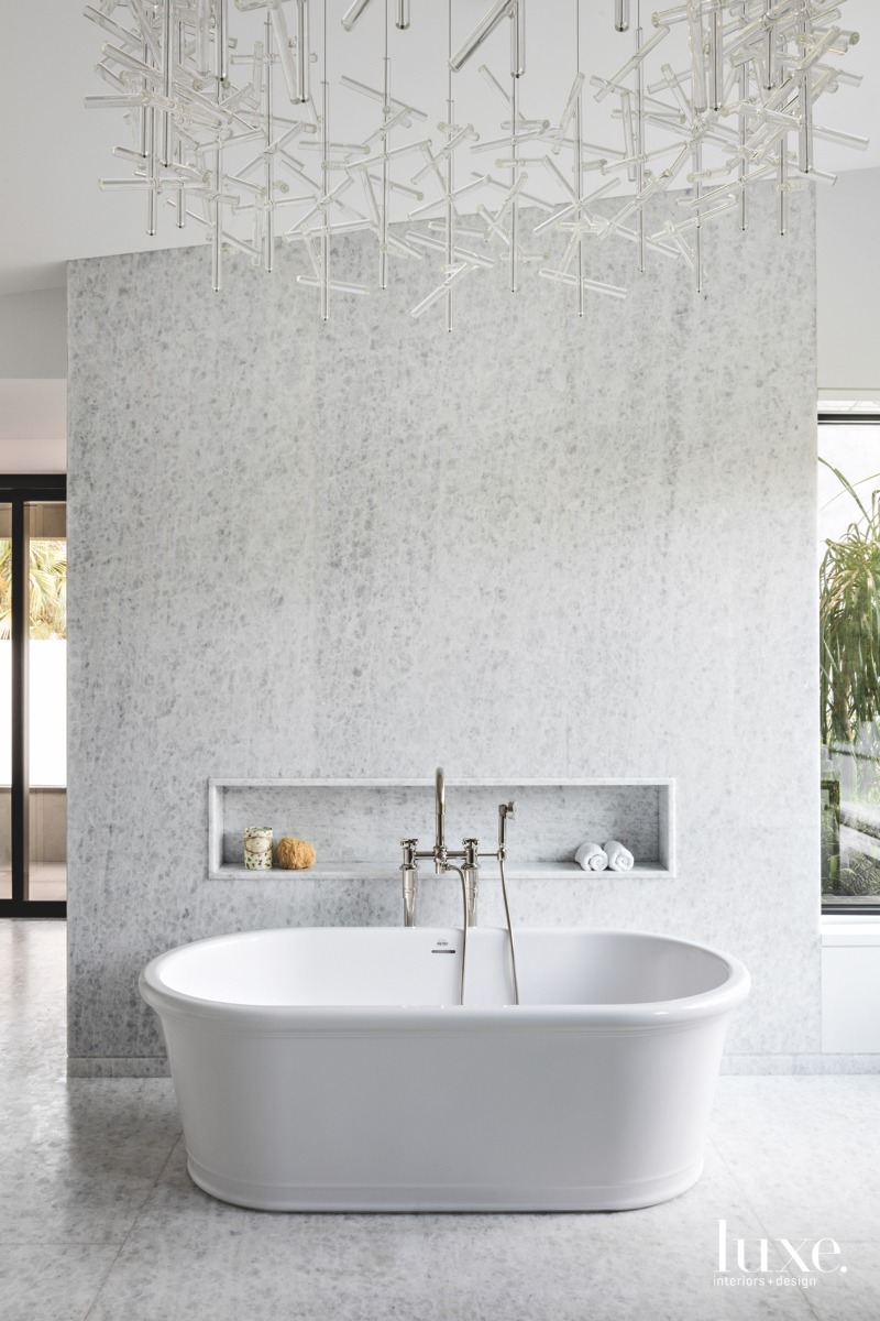 modern white bathroom freestanding white...
