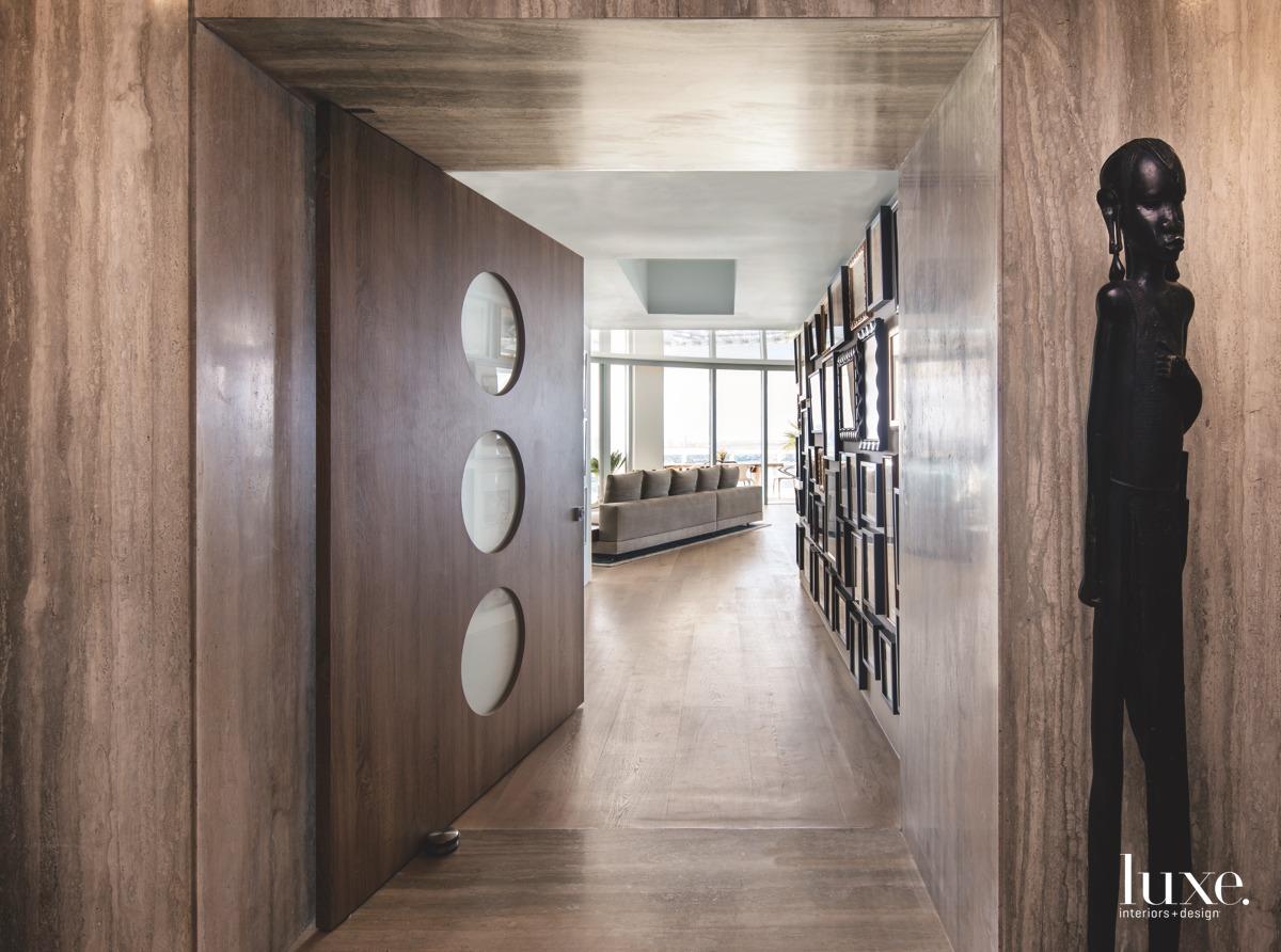 modern entry pivoting door brown