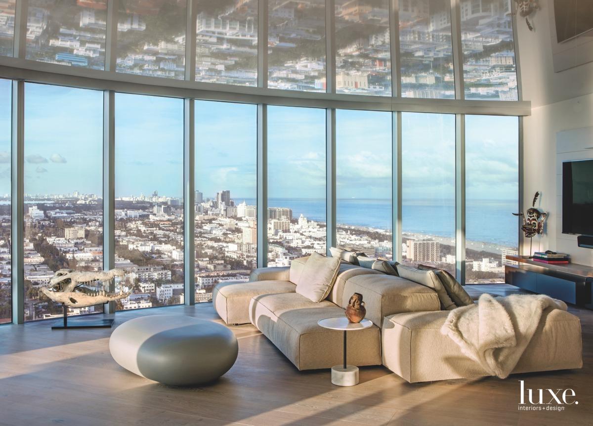 modern living room neutral glass...