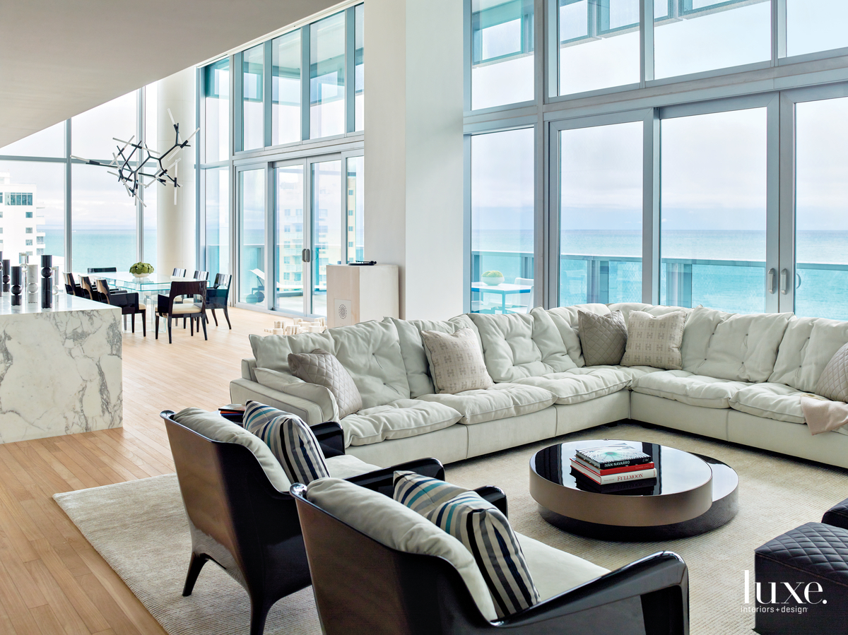 modern living room neutral floor-to-ceiling...