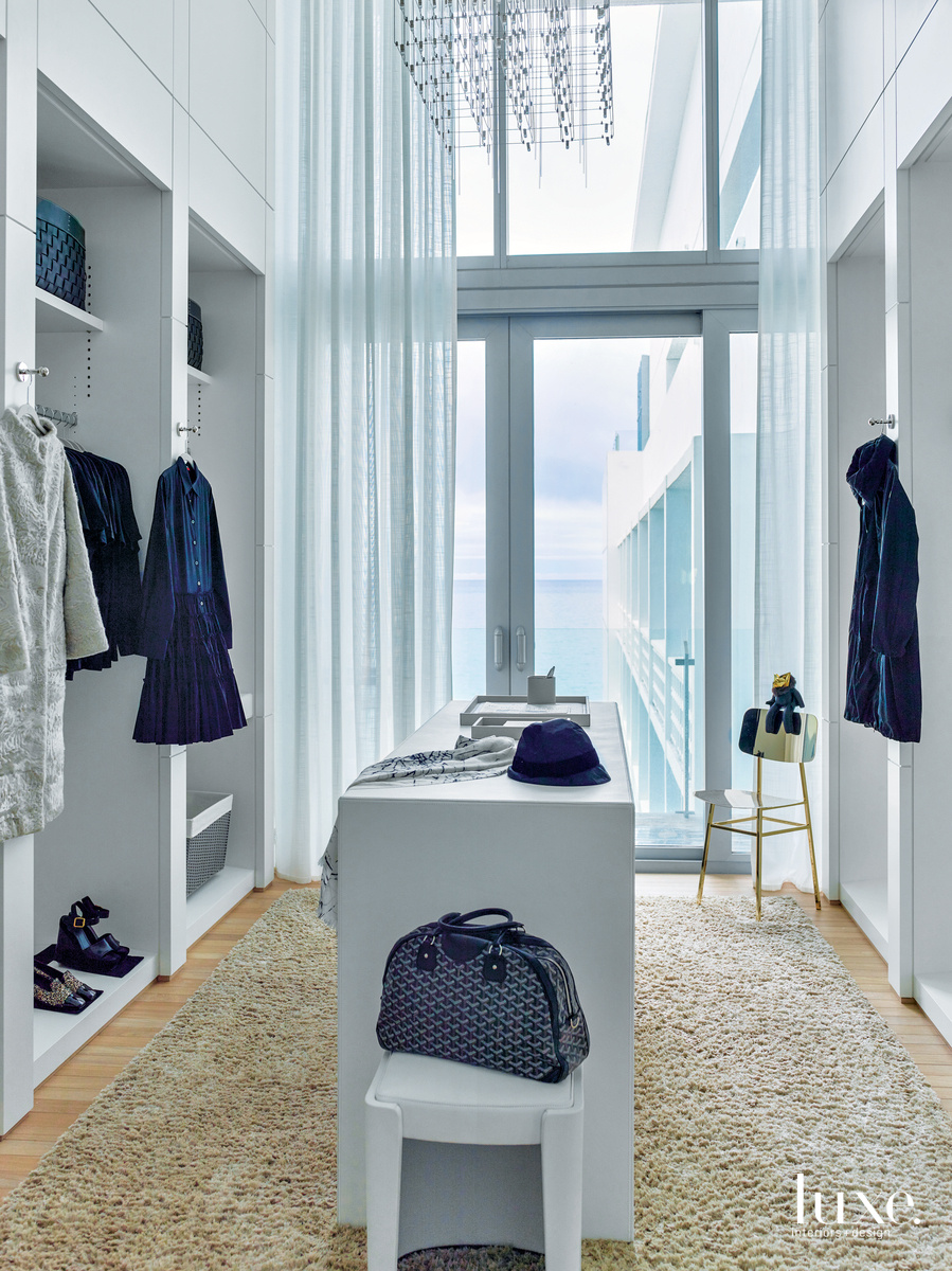 modern closet in bedroom blue...