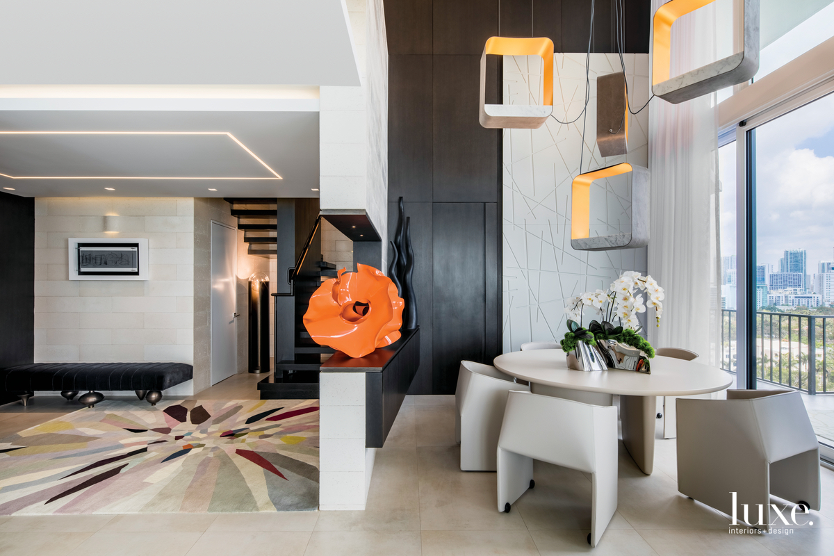 contemporary foyer and dining room...