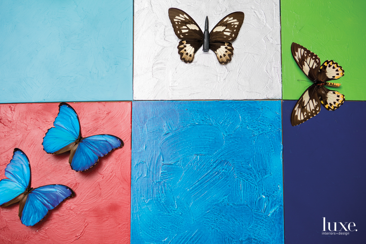 "One of Robierb's works consists of real butterfly wings attached to bullets on painted square canvases. ""My idea is to make a whole wall with them,"" he says."