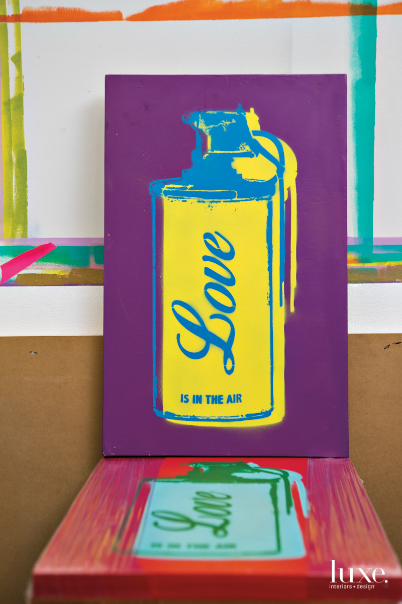 "Made for a political show, Robierb's Love Army series of spray-painted icons on wood portrays a can of what he envisions ""love gas,"" rather than hand grenades."