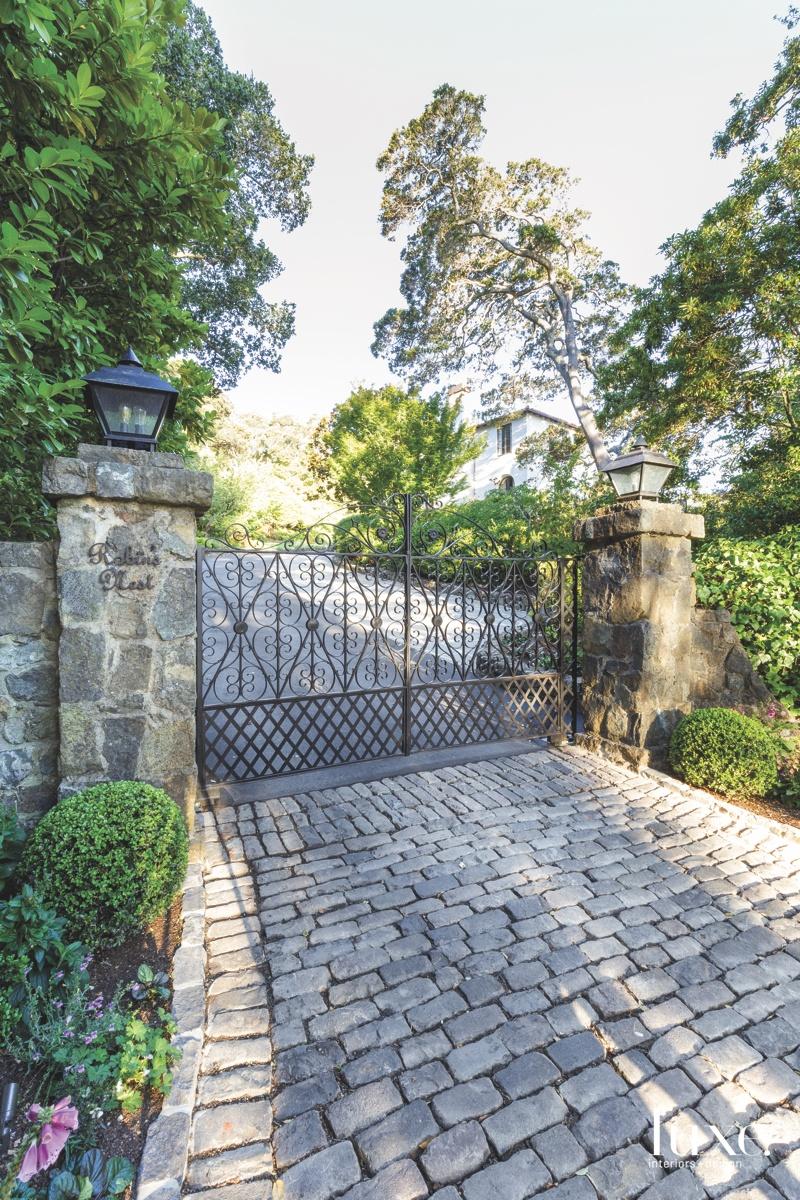 exterior driveway black gate stones