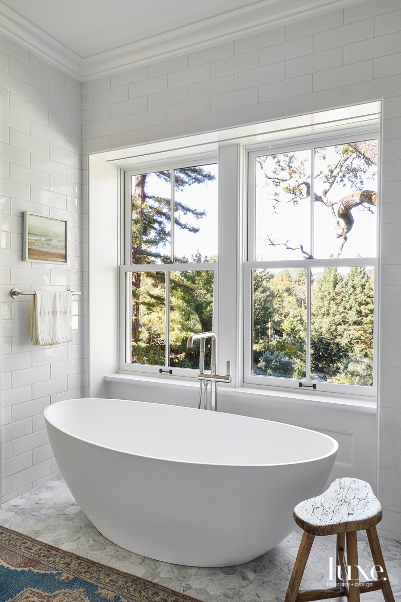 contemporary white bathroom freestanding tub