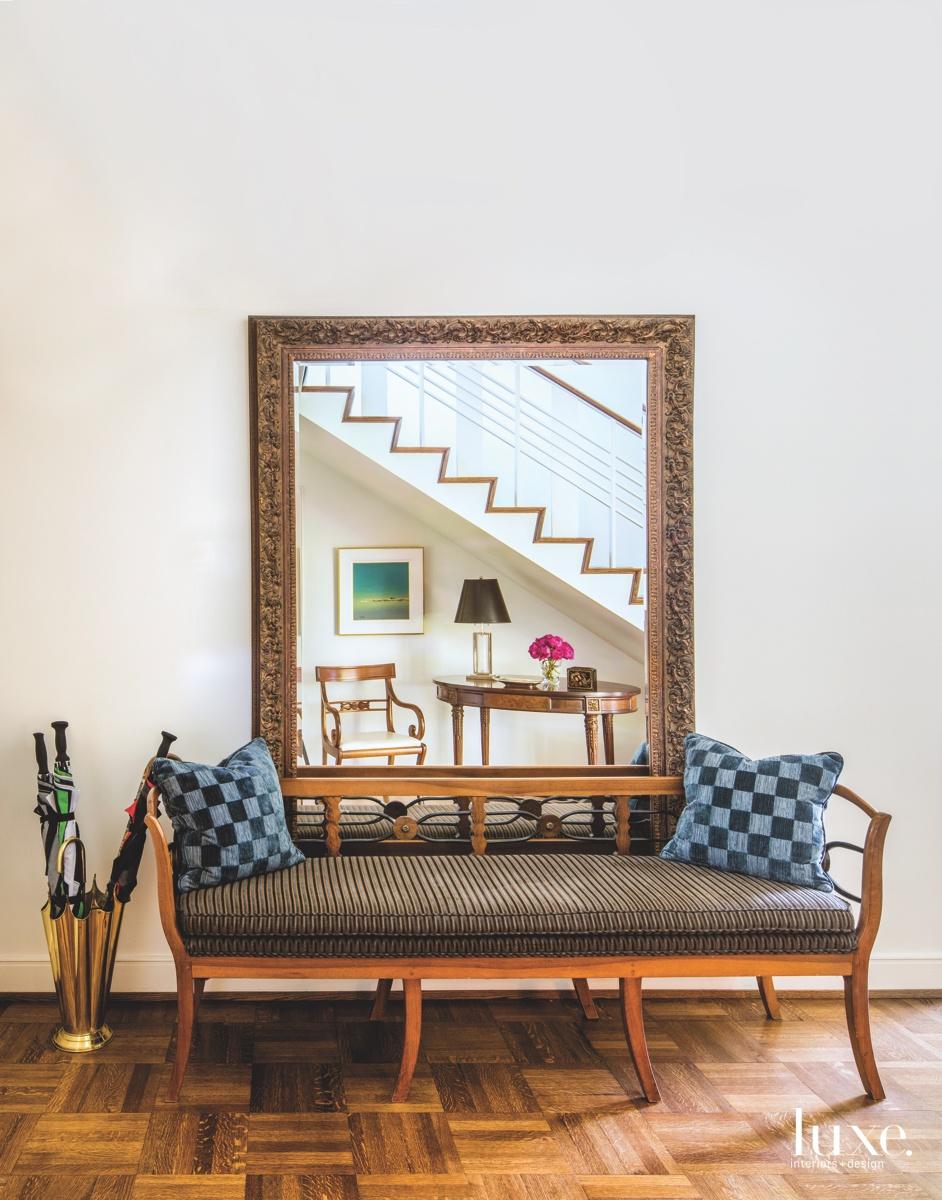 mid-century modern staircase mirror sitting...