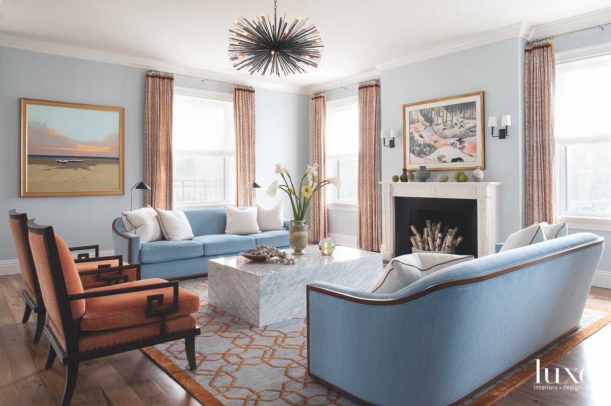 transitional living room orange and...