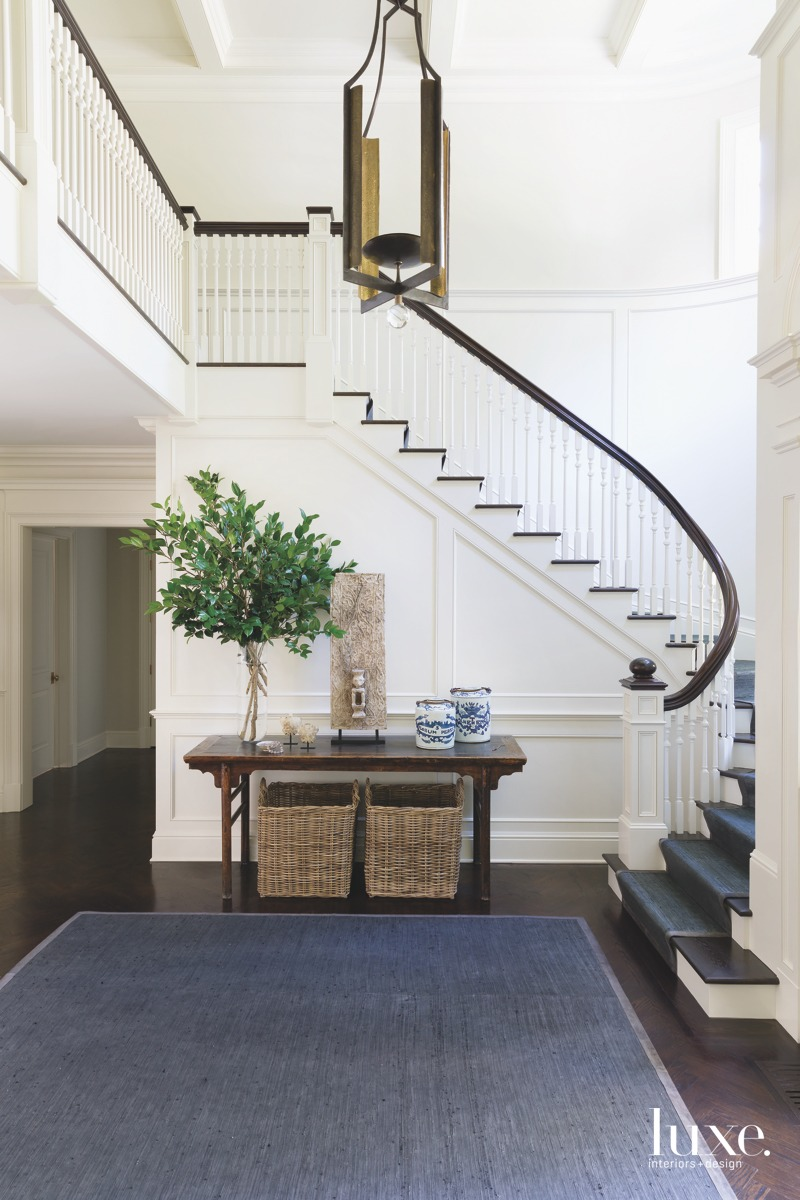 contemporary foyer staircase rug