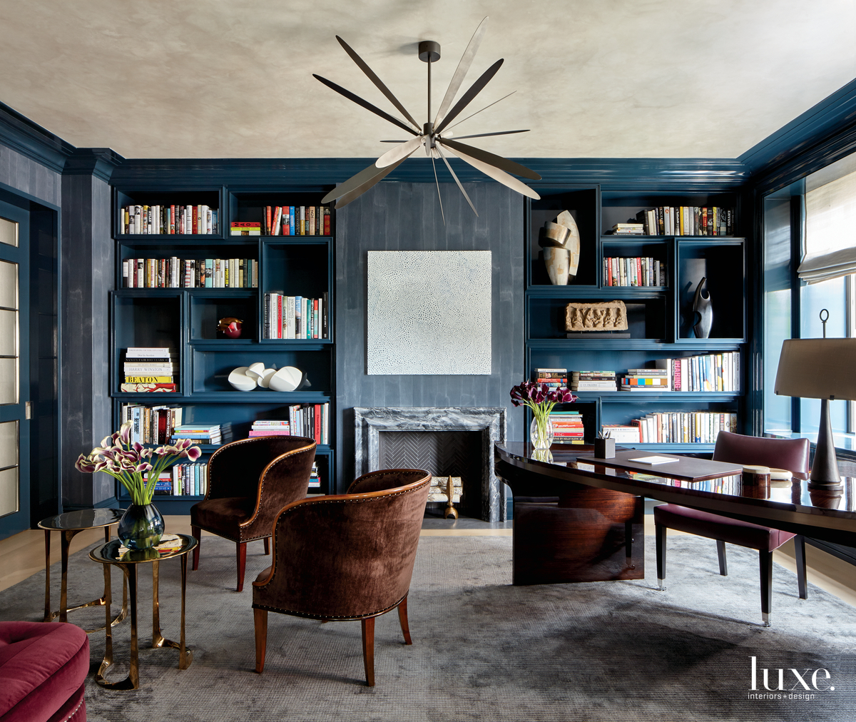 contemporary study dark blue walls...