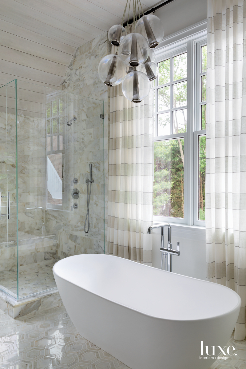 rustic neutral bathroom white freestanding...