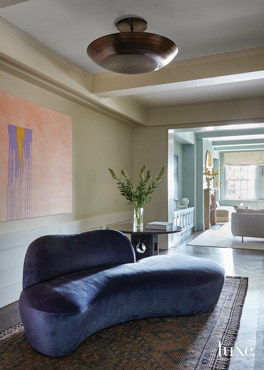eclectic foyer vintage blue sofa