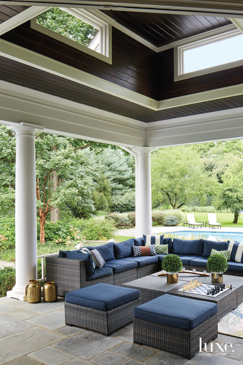 transitional outdoor sitting area navy...