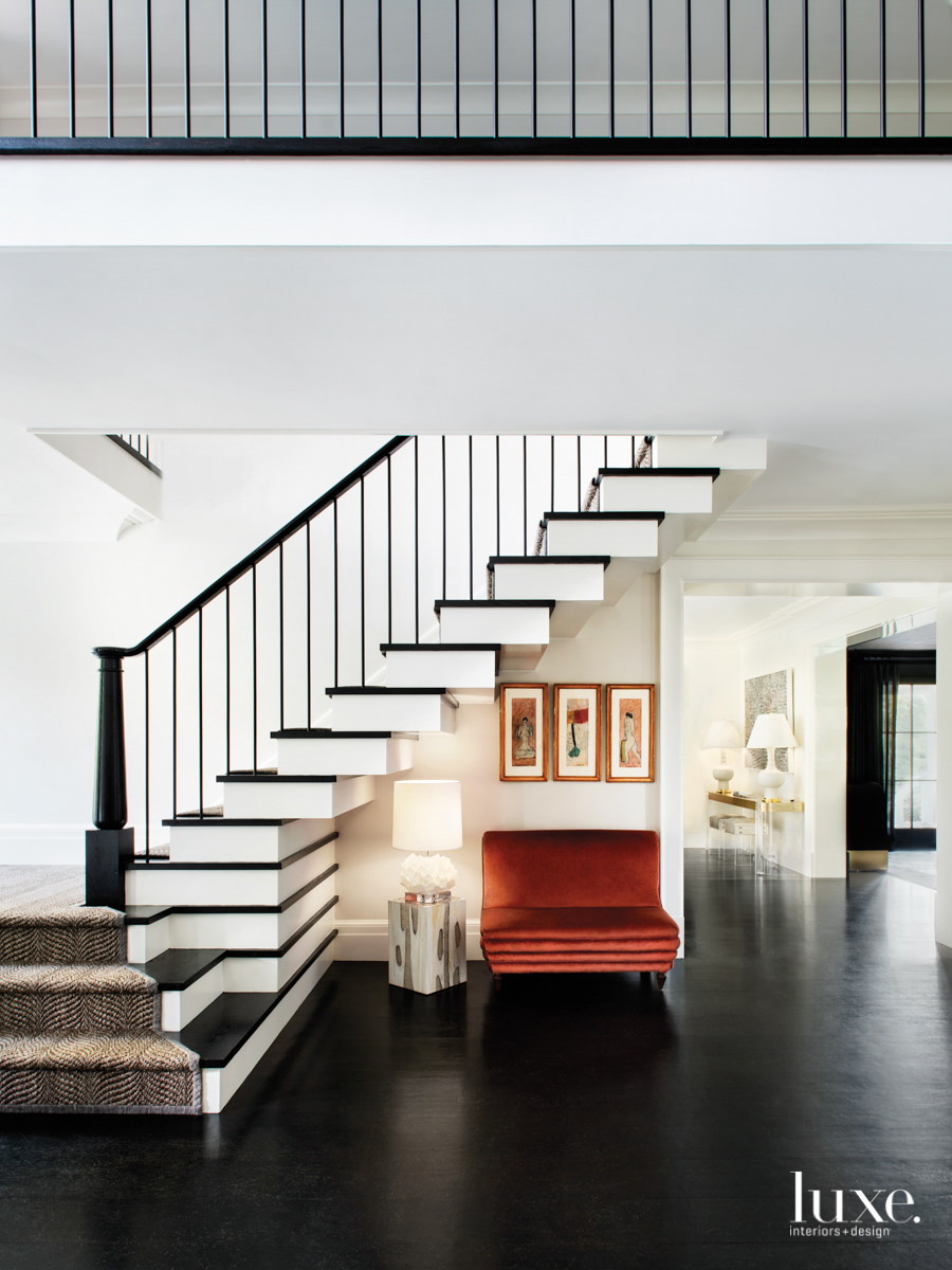 contemporary foyer black flooring staircase...