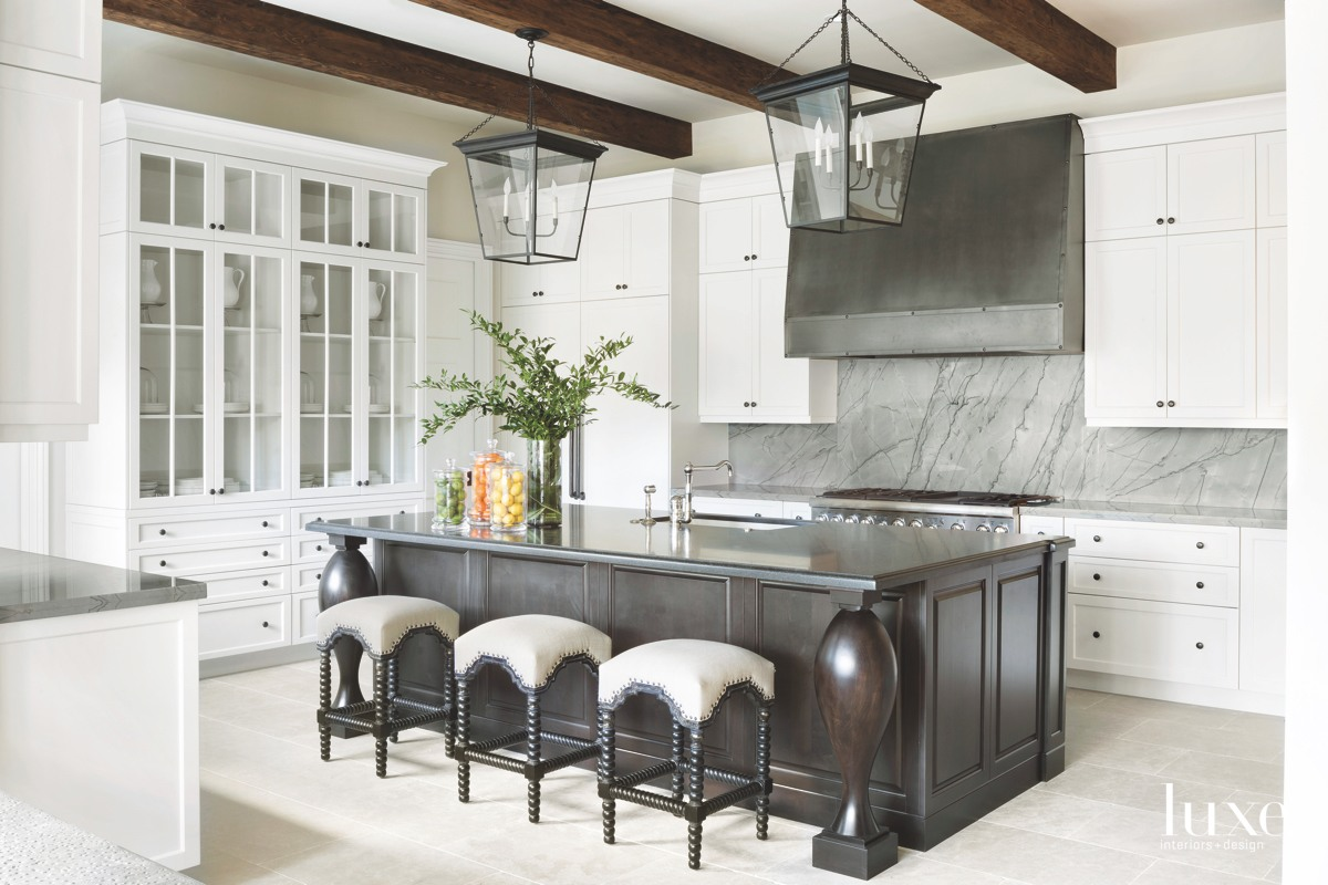 mediterranean kitchen white cabinetry black...