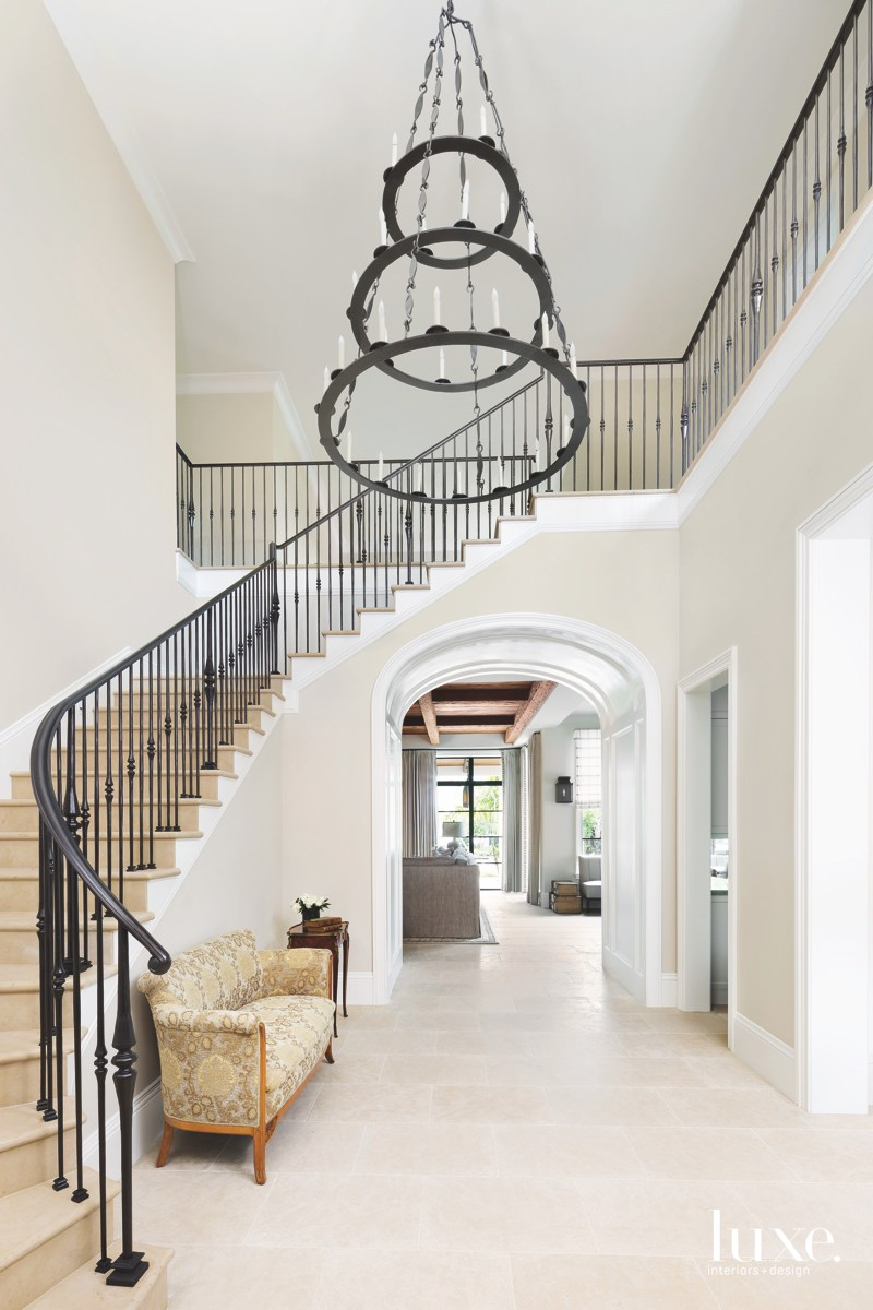 mediterranean neutral entry foyer staircase...