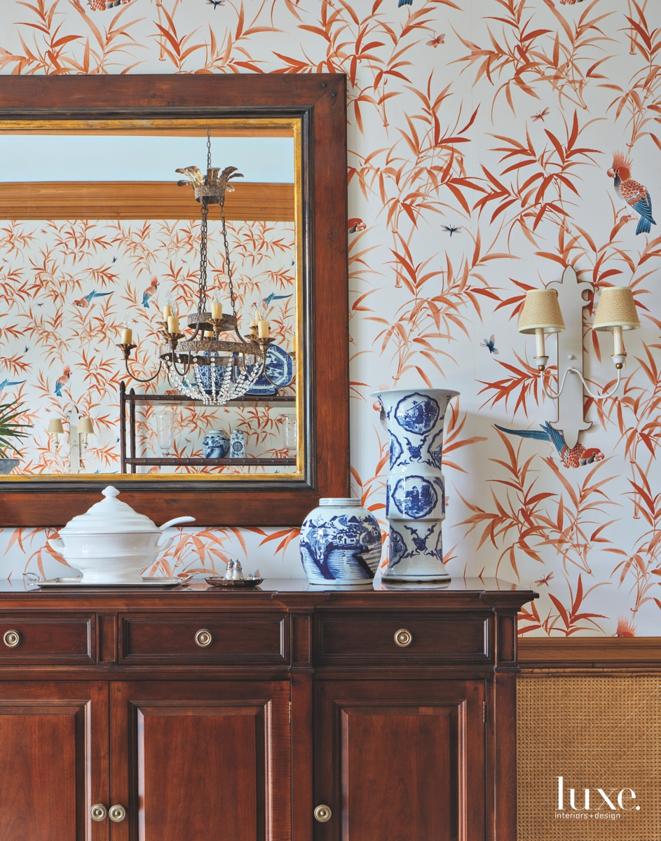 traditional dining room orange wallpaper...