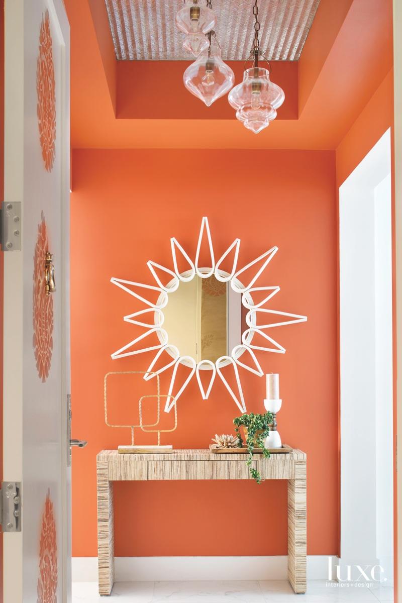 coastal orange entryway rattan mirror