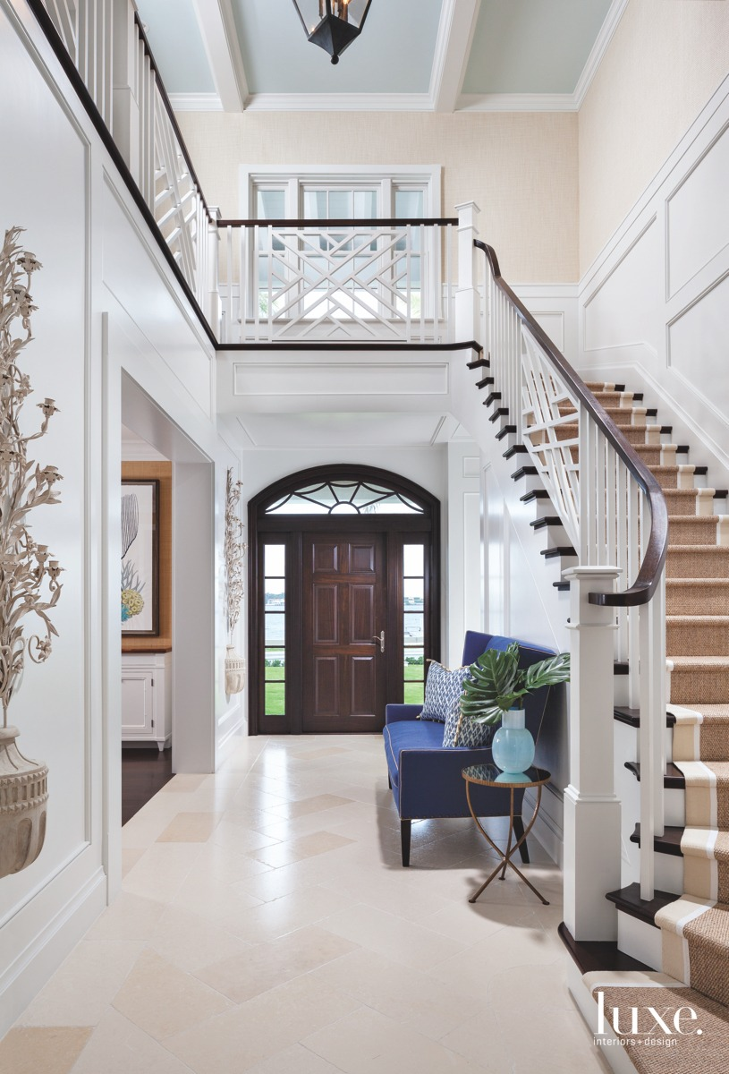 traditional foyer staircase mahogany paneled...