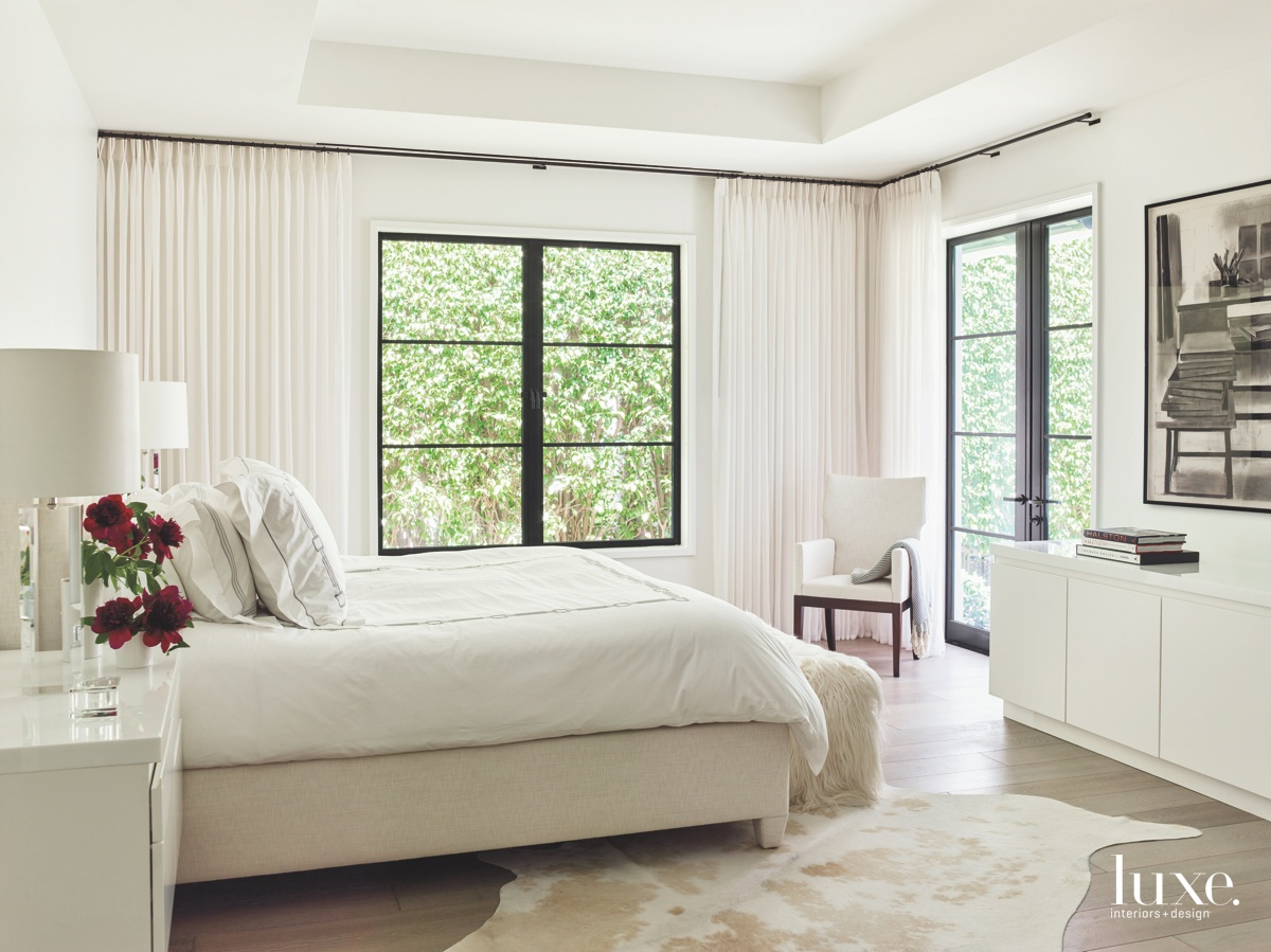 transitional white bedroom white bed