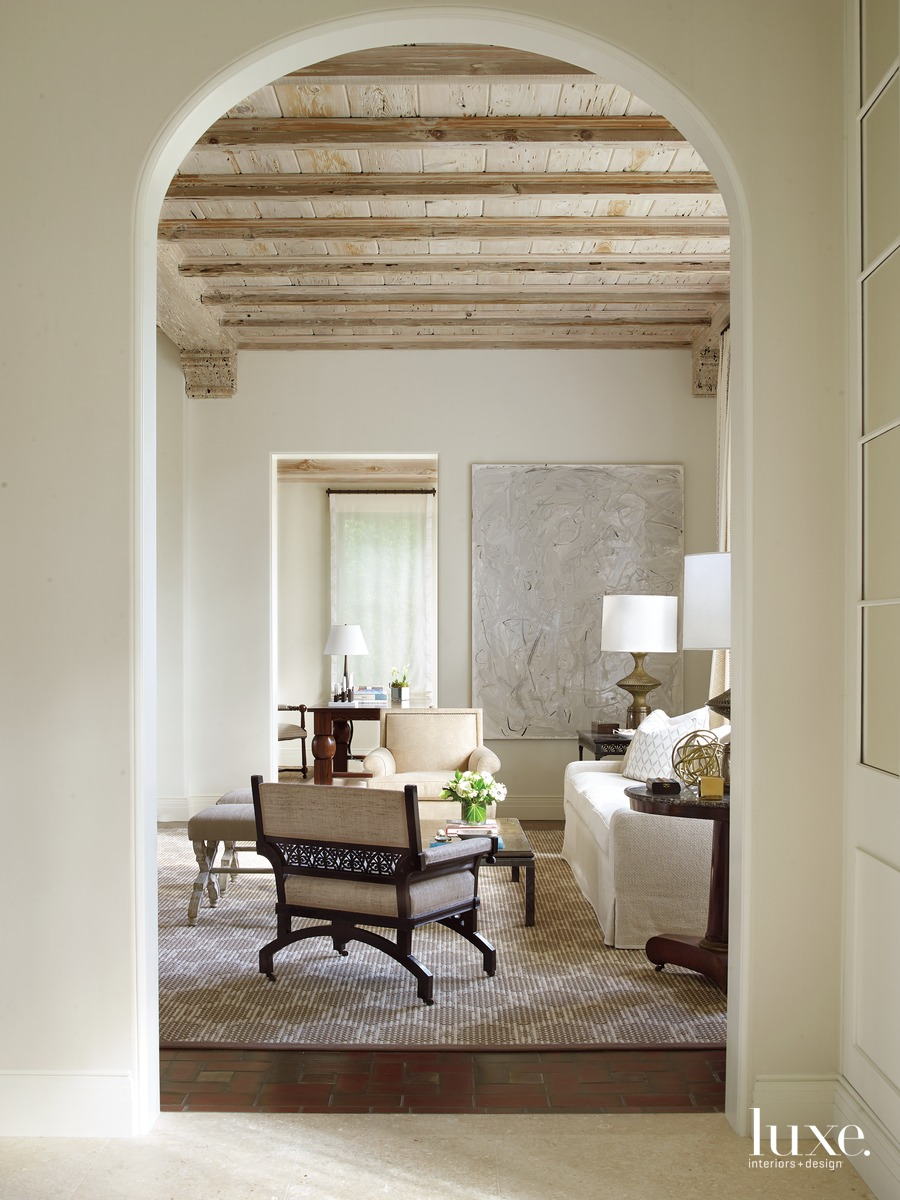 mediterranean living area arches entryway
